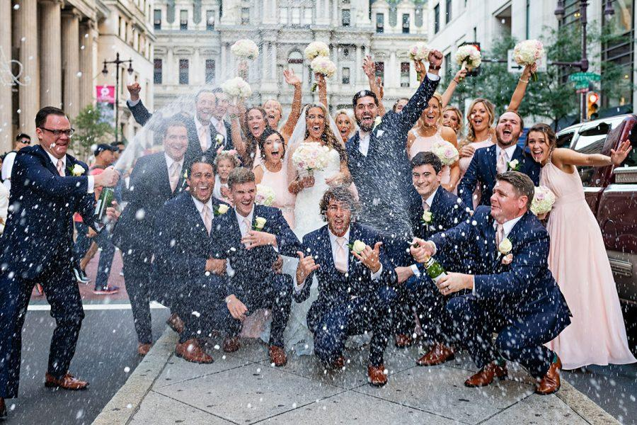 wedding party with champagne on front street city hall philadelphia, daniel moyer photography