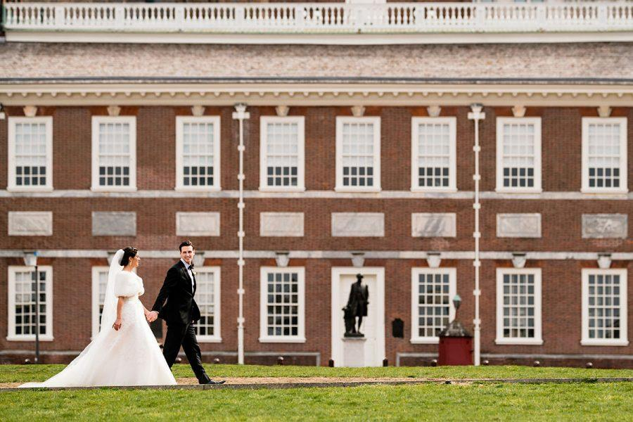 bride and groom walking in front of independence hall, daniel moyer photography