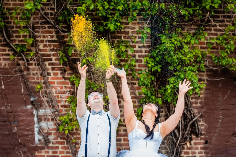 bride and groom throwing up holi powder during engagement session