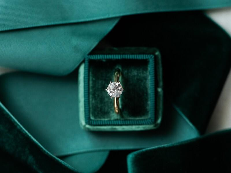 Engagement ring in green velvet box