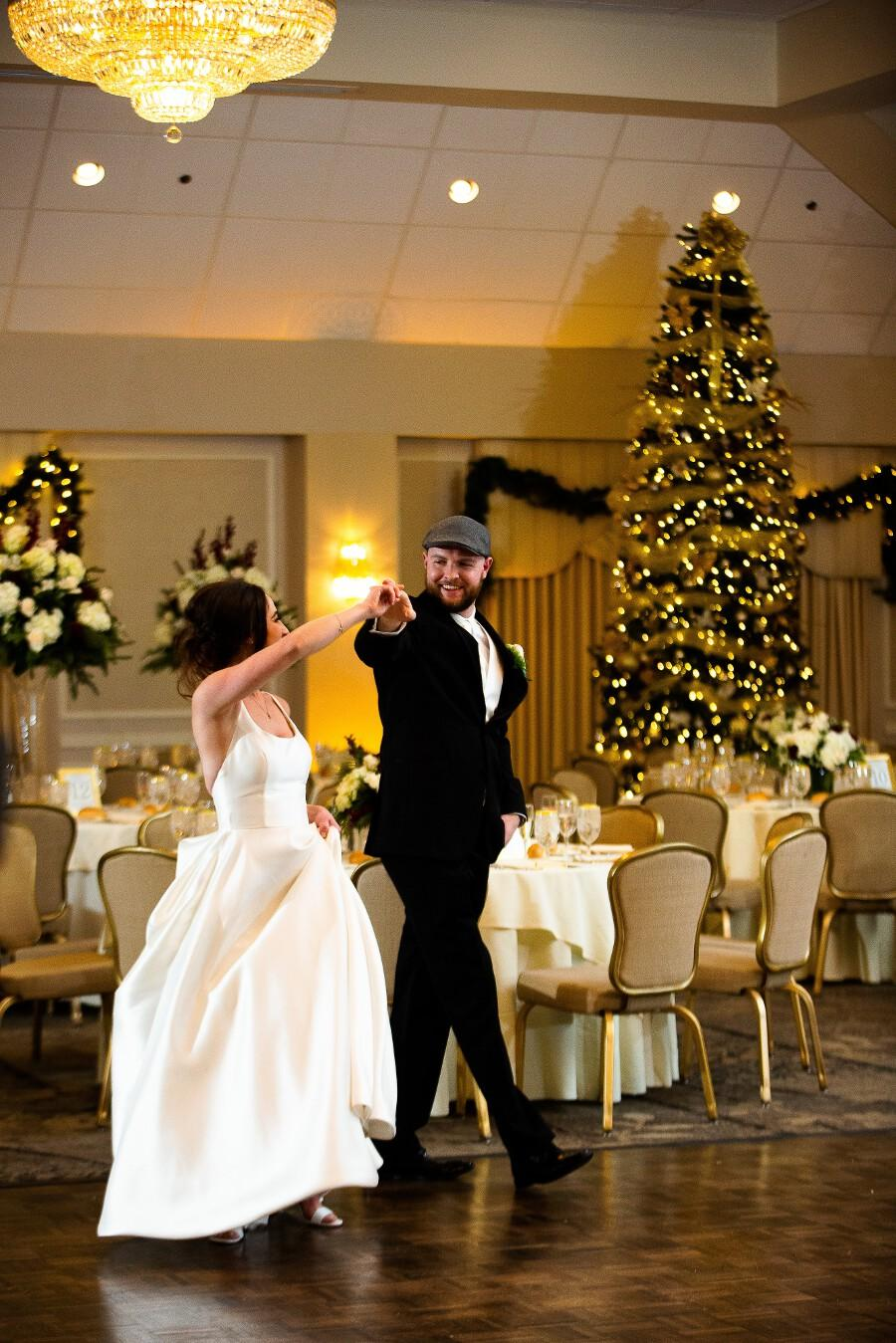 Bride and groom walk in dancing steps in reception room