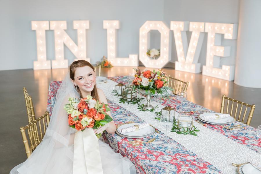Gabrielle Belardo, location 215 wedding, slay displays sign