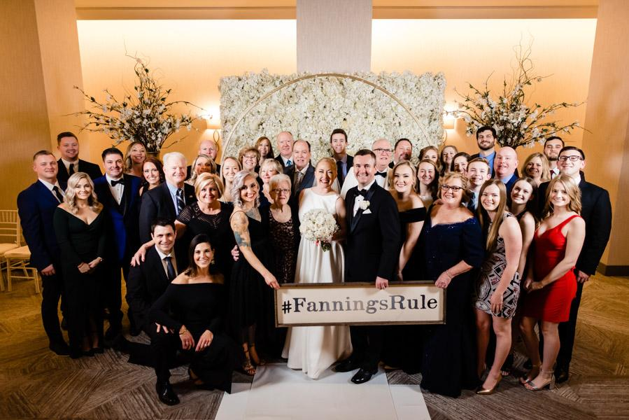 Bride, groom, and their families posting with their family hashtag #FanningsRule