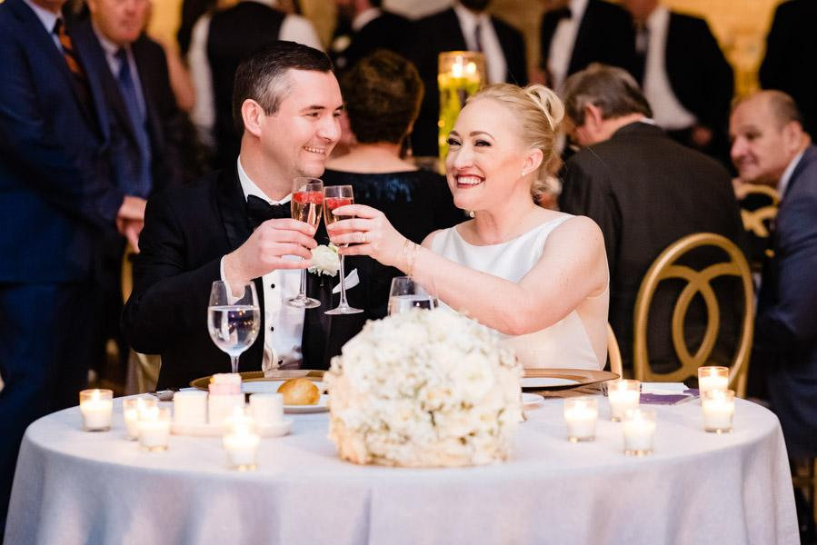"Bride and groom ""cheers"" from their sweetheart table"
