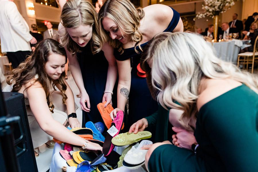 Wedding guests select shoes to change into