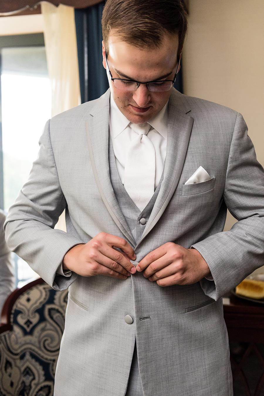 groom dressed in suit on wedding day by ashley gerrity photography and philly in love
