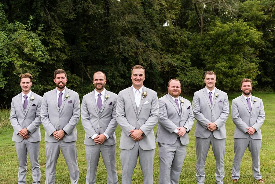 groom and groomsmen wearing suits in wedding by ashley gerrity photography and philly in love