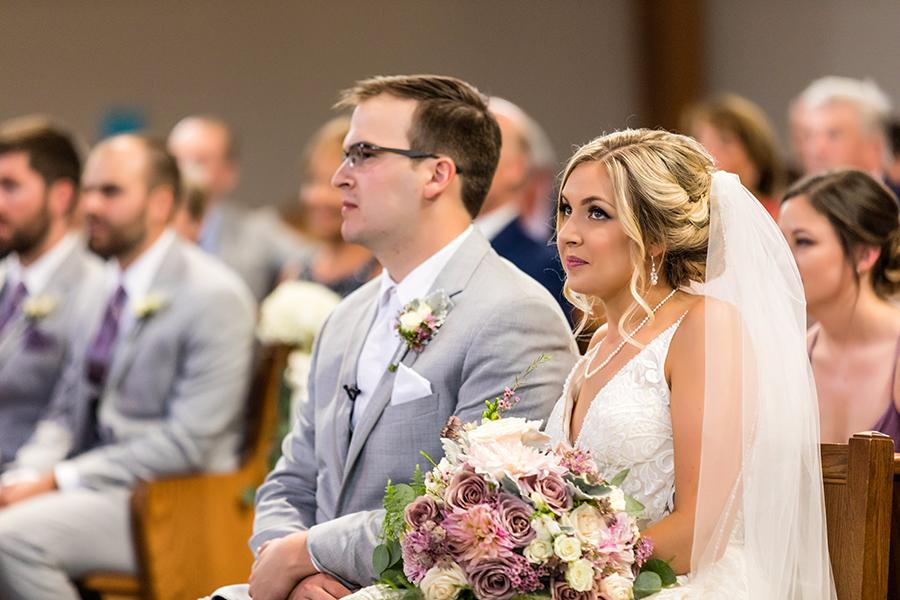 bride and groom at wedding in church by ashley gerrity photography and philly in love