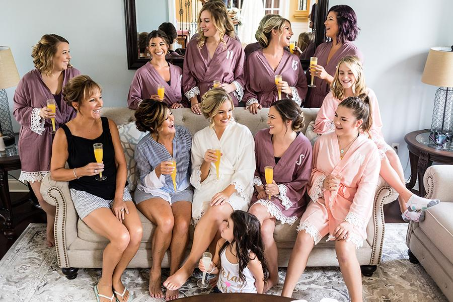 bridal party having a toast by ashley gerrity photography and philly in love