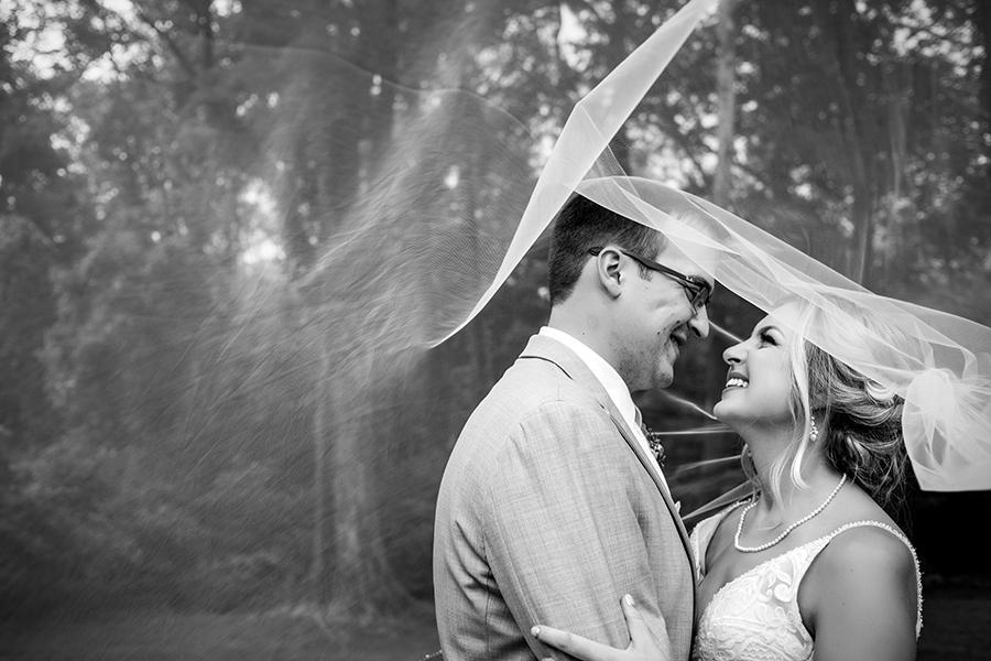 married couple under bridal veil at anthony wayne house by ashley gerrity photography and philly in love