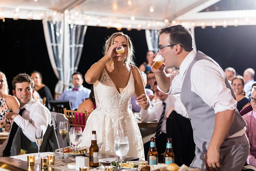 bride and groom play beer pong during wedding at anthony wayne house by ashley gerrity photography and philly in love