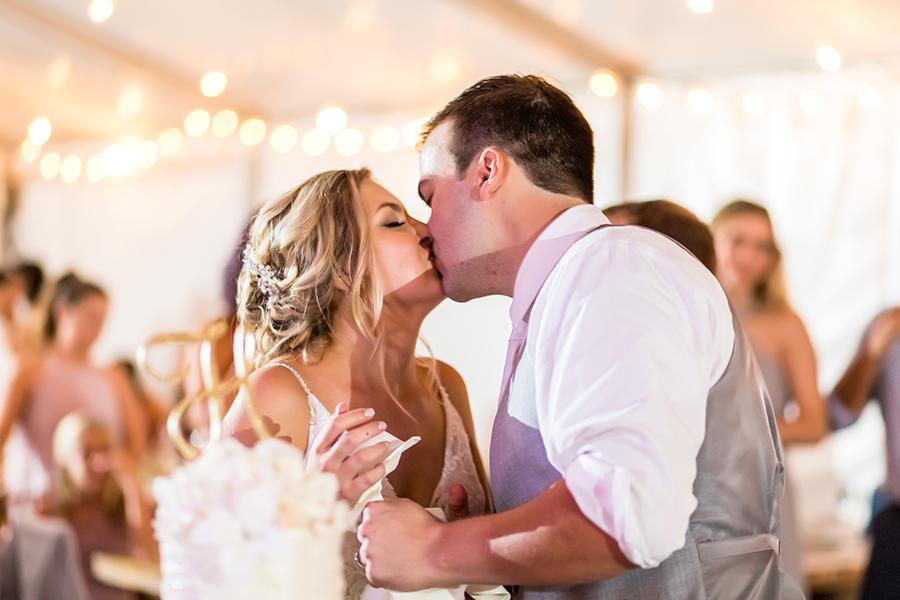 married couple kiss at wedding reception at anthony wayne house by ashley gerrity photography and philly in love