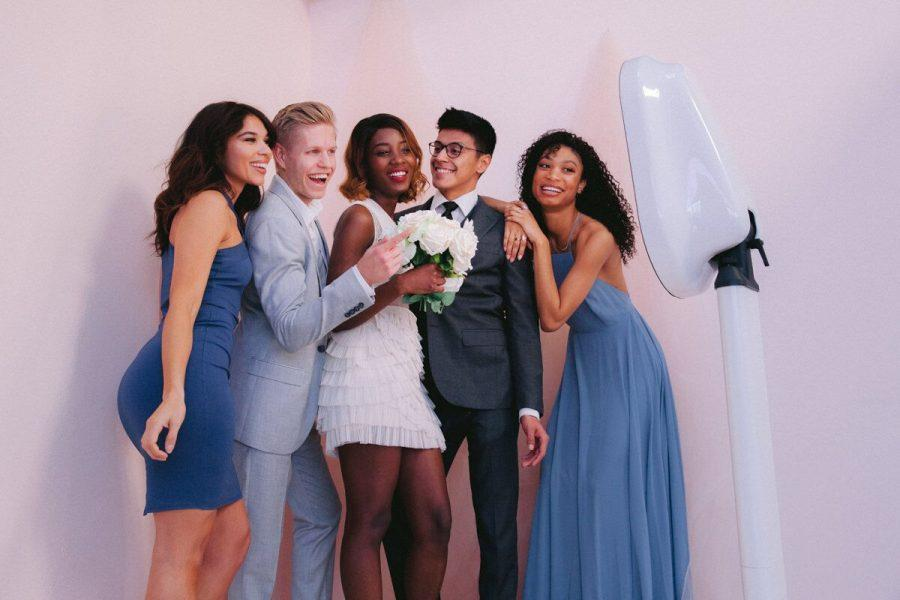 bride and groom and bridal party in front of super selfie station photo booth