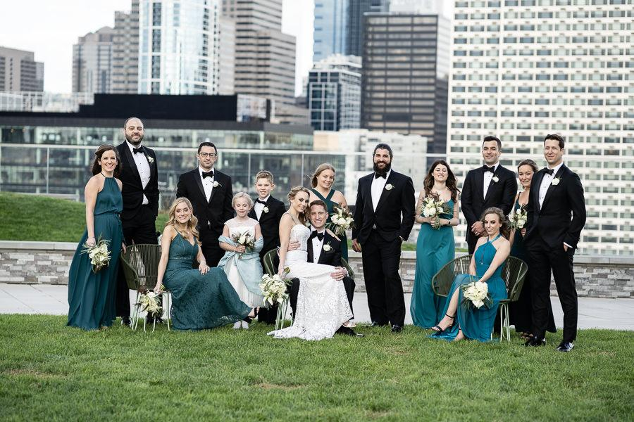 Bridal party posing with Philadelphia in the background