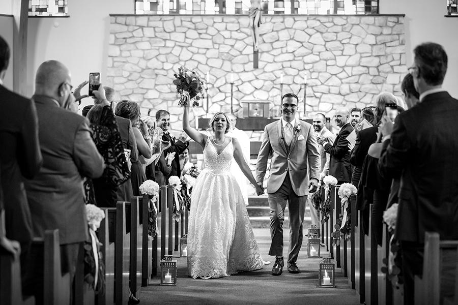 married couple in church on wedding day by ashley gerrity photography and philly in love