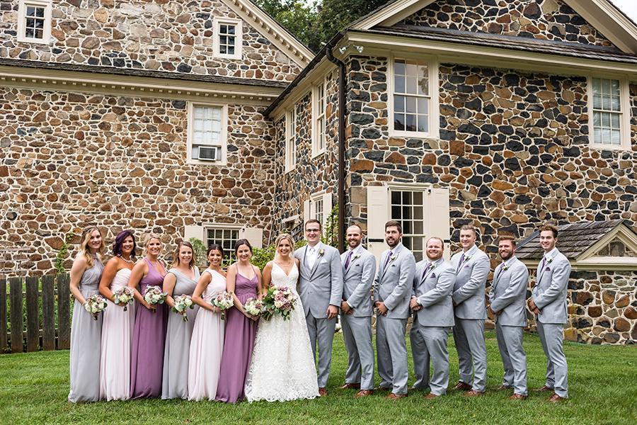 bridal party posing on lawn of anthony wayne house by ashley gerrity photography and philly in love
