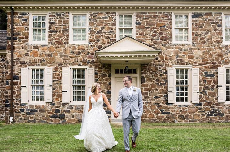 bride and groom holding hands at historic wayne house philly in love blog