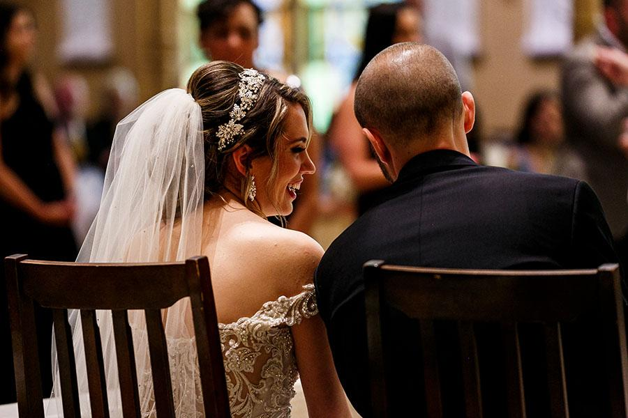 couple seated during wedding at old st joseph's church by daniel moyer photography
