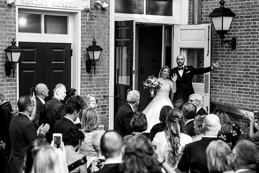 bride and groom outside church by daniel moyer photography