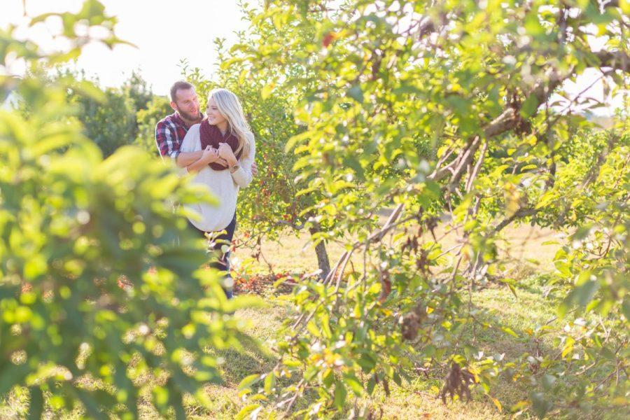 couple hugging in vineyard