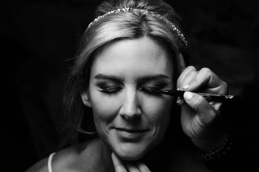 bride getting makeup done by j & j photography studios