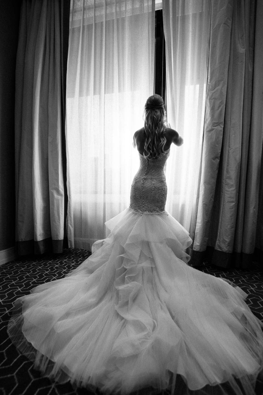bride by hotel window by j & j photography studios
