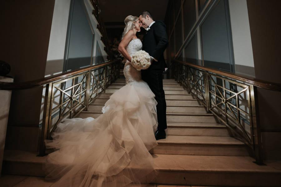 bride and groom on stairs by j & j photography studios