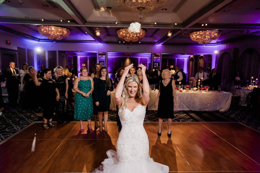 bride tosses bouquet at wedding