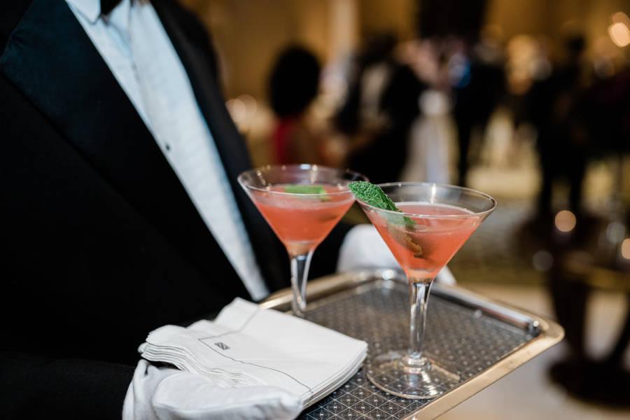 maitre'd serving cocktails