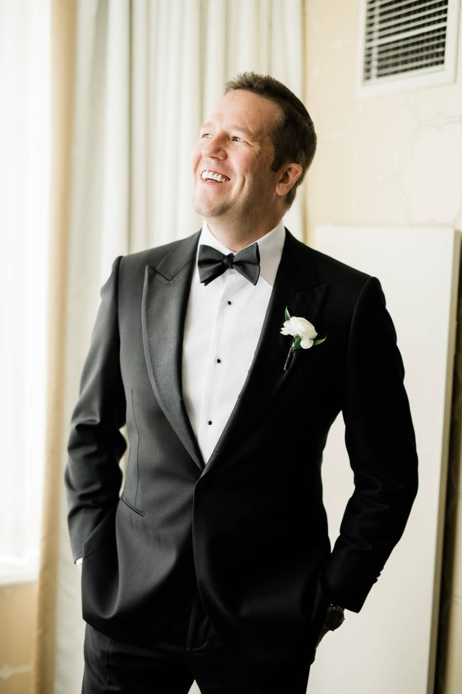 groom in classic black tuxedo by j & j photography studios