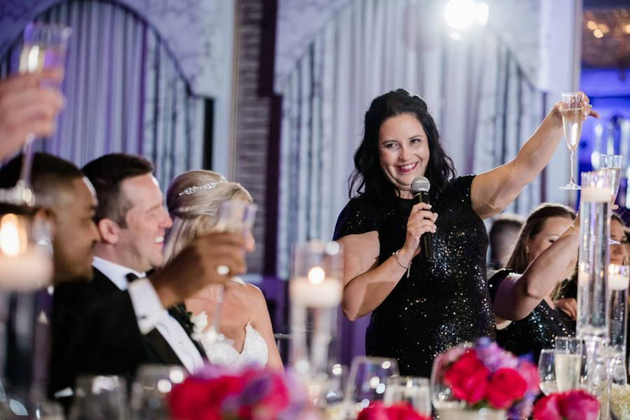 maid of honor toasts bride and groom at wedding reception