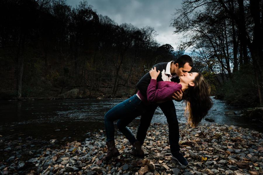 man dipping women by creek