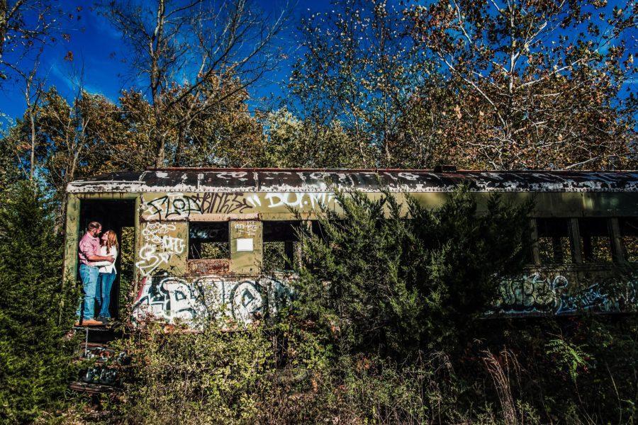 couple embracing on abandoned train car