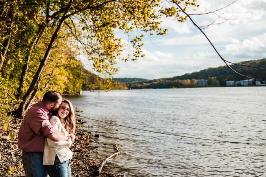 couple hug by the water