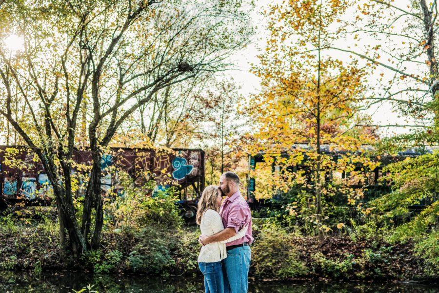 couple embrace in the woods