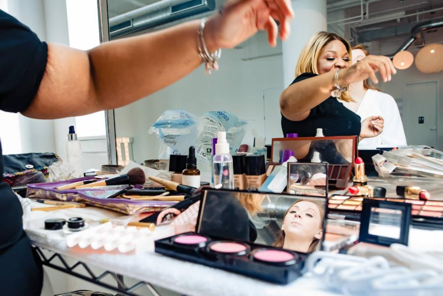 makeup artist Dolly Marshall applies makeup for bride