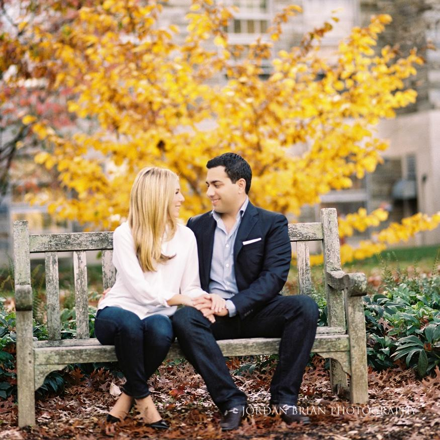 couple sitting on bench in college campus