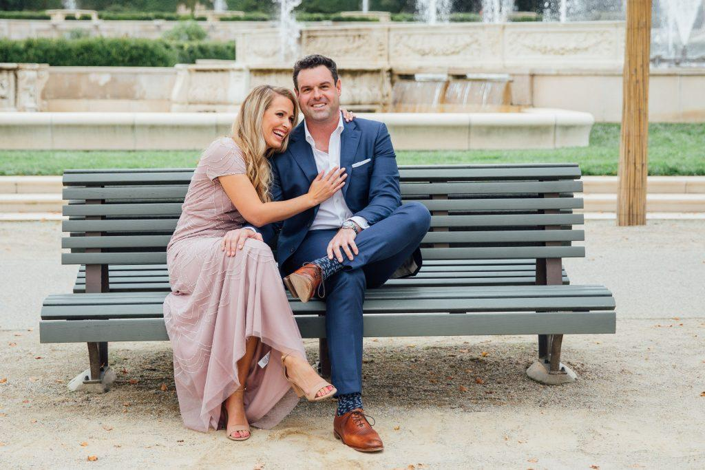 couple laughing on bench