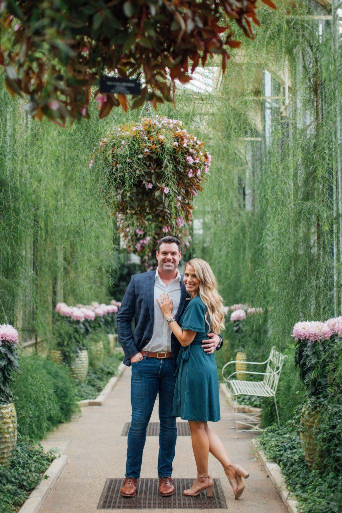 couple posing in botanical garden