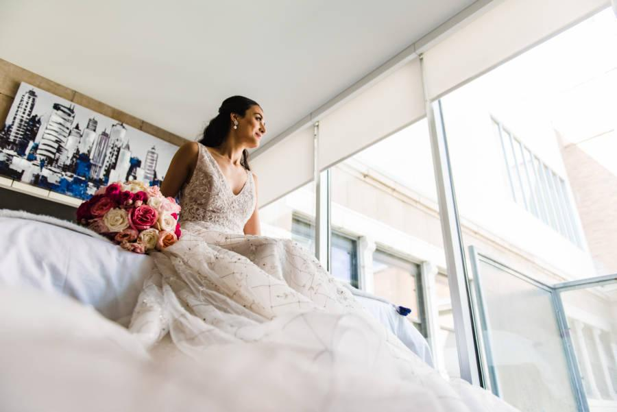bride on her wedding day holding bouquet