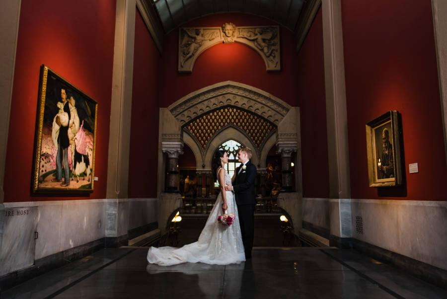 bride and groom in museum