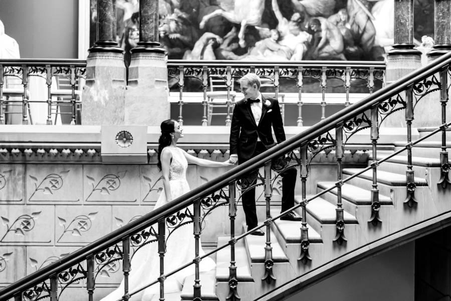 bride and groom standing on staircase