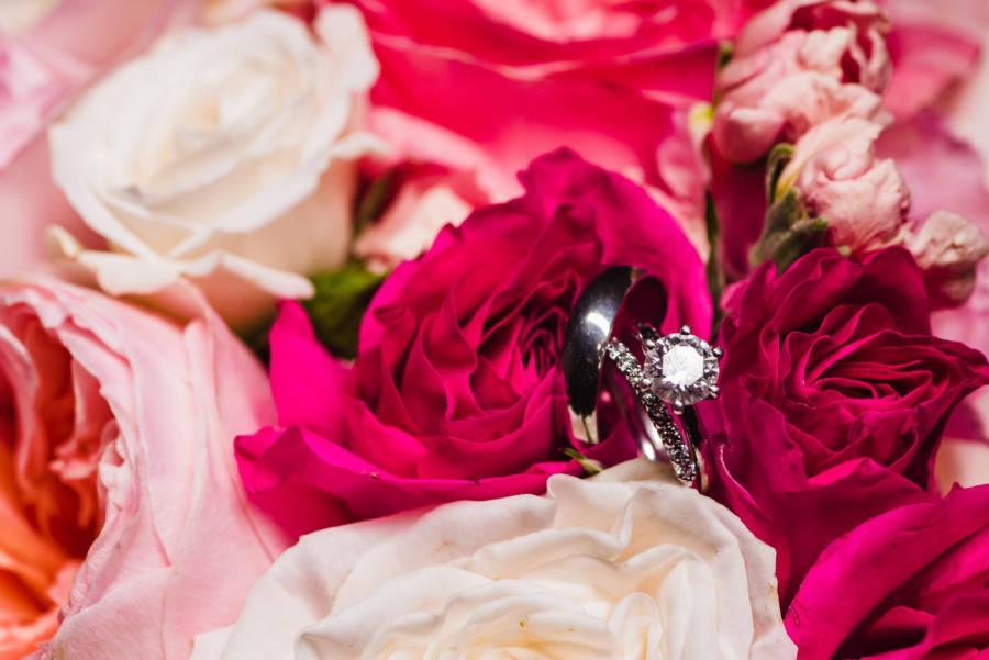 wedding rings nestled in flowers
