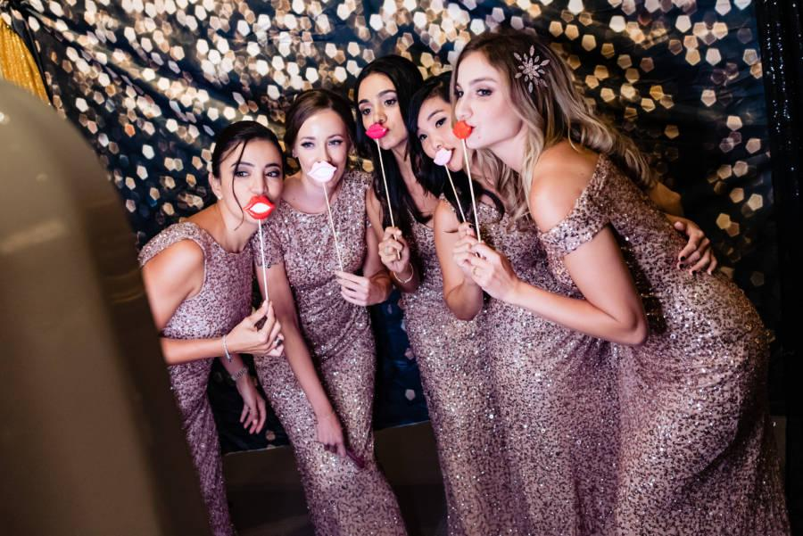 bridesmaids pose for picture at wedding reception