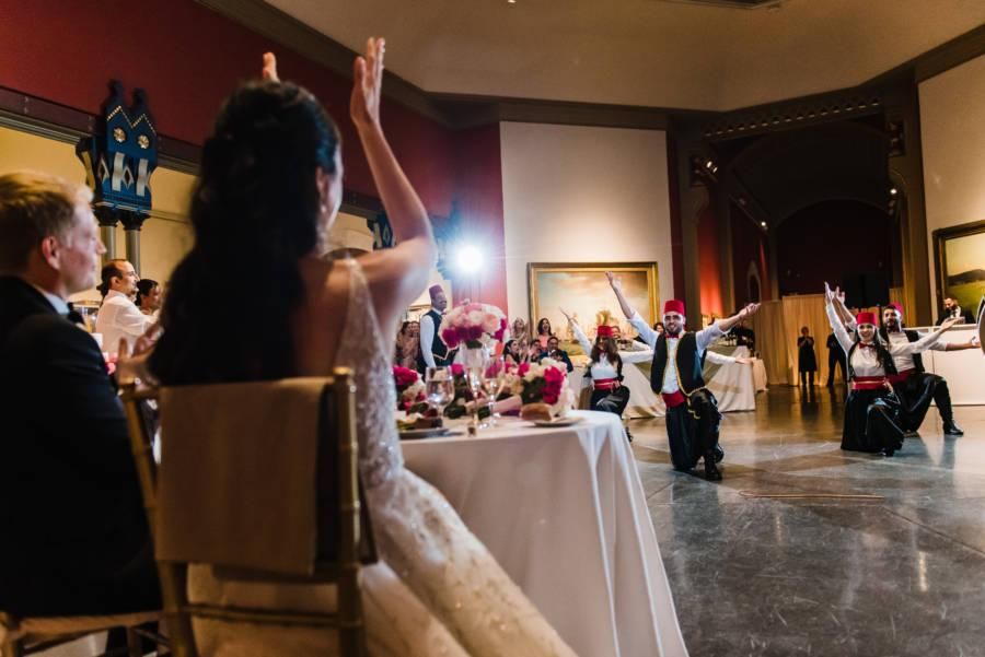 bride and groom enjoy Lebanese dance performance