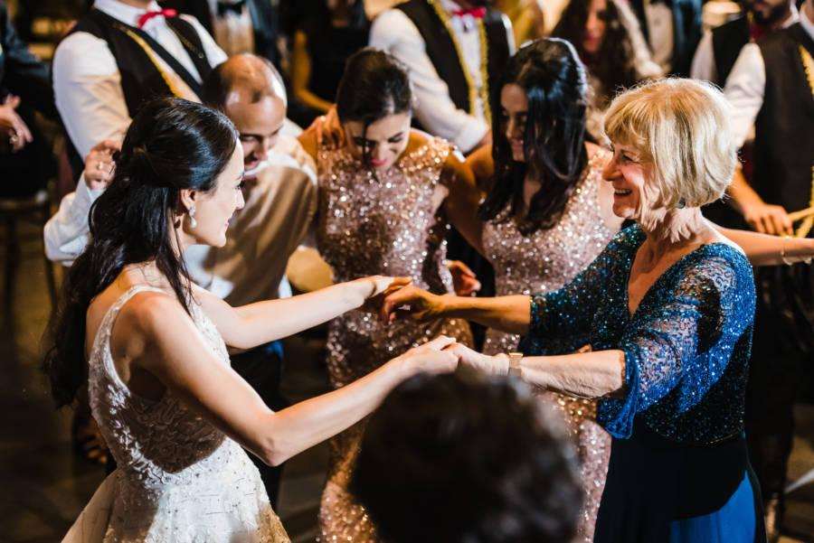 bride dances with mother-in-law at wedding reception