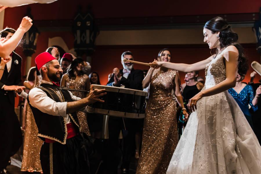 bride beating Lebanese drum at wedding reception