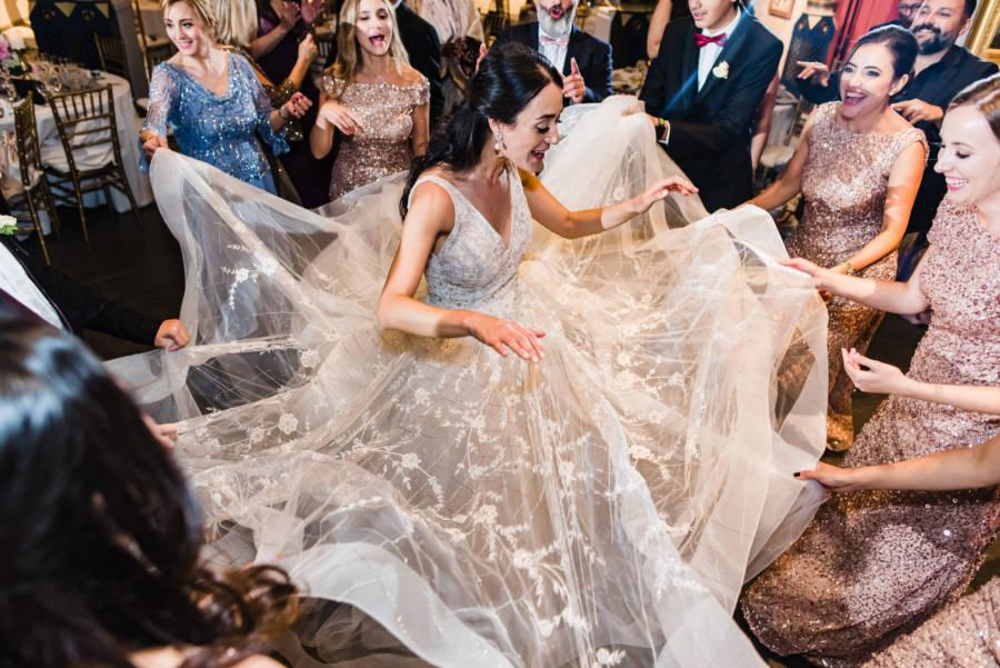bride and bridesmaids dance at wedding