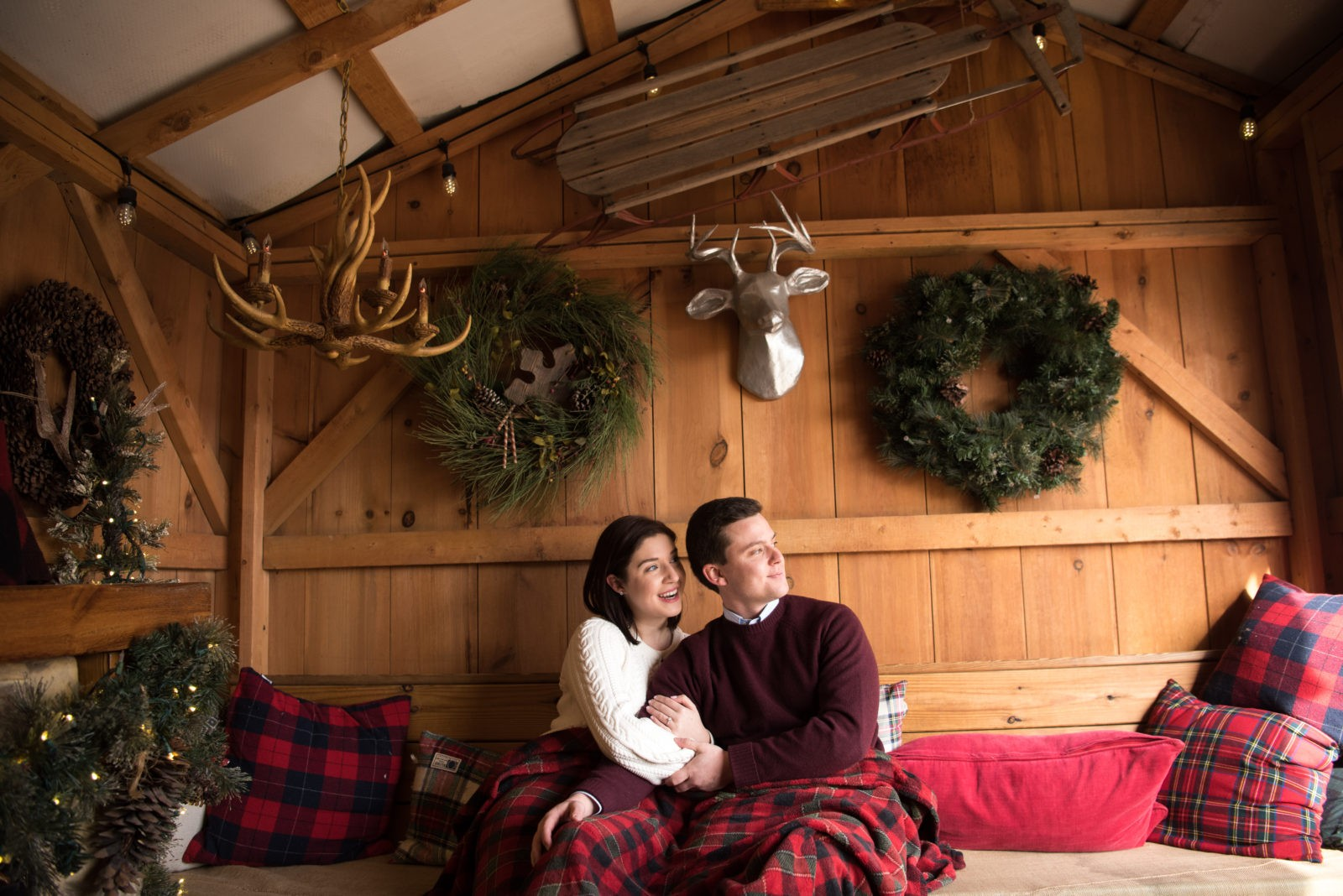 couple sitting on couch in wood cabin