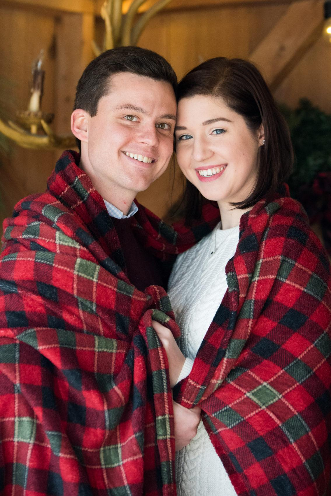 couple wrapped in plaid blanket